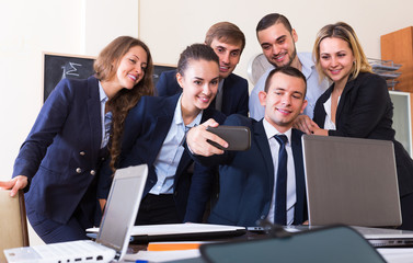 Office workers making selfie together