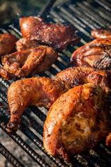 Chicken cooking on an open fire