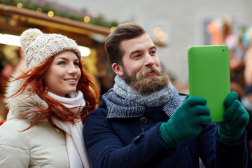couple taking selfie with tablet pc in old town