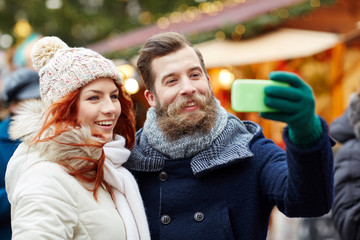 couple taking selfie with smartphone in old town