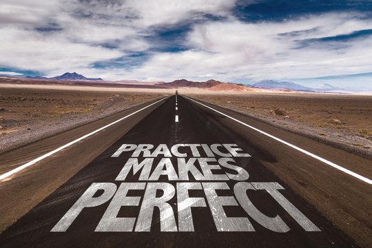 Practice Makes Perfect written on desert road