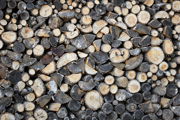 Pile of natural wooden logs background