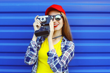 Fashion pretty cool girl wearing a colorful clothes with retro c