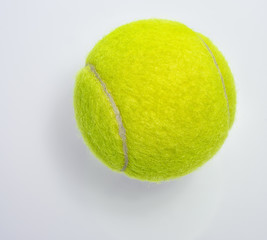 New tennis ball on white background