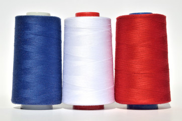 Blue, white and red thread