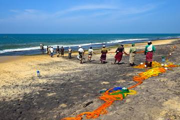 Sri Lanka, November 14: Indian Ocean fishermen pull the net with