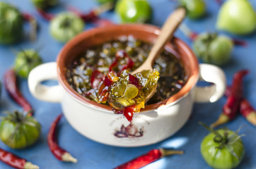 Jam of green tomatoes with chili