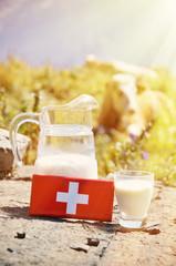Wall Mural - Swiss chocolate and jug of milk against mountain peak. Switzerla