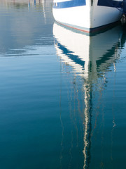 yacht reflection in the water in the marina