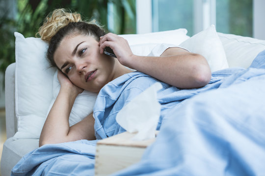 Sick woman with phone