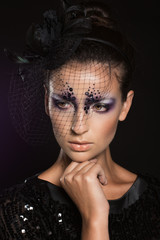 Face of girl with fashion makeup under veil