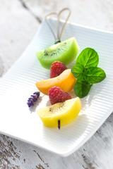 Fruit skewer on a white platter