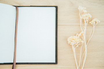 Line paper notebook open on wood texture background