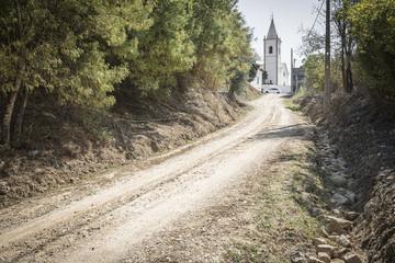 a country road and a white church - Sao Pedro de Tomar, Portugal