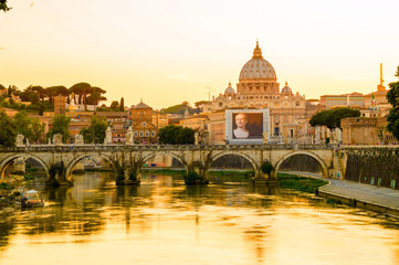 Rome and Vatican cityscape at sunset with bridge on the Tiber
