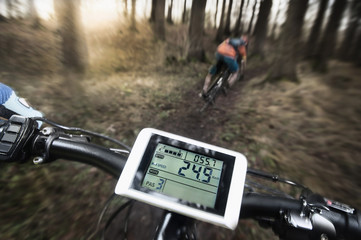 Driving view of mountain biking down hill descending fast on bicycle, Bavaria, Germany