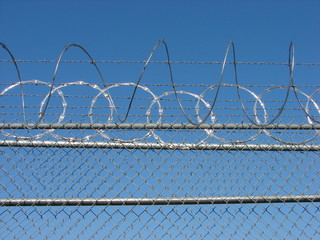 Razor Wire Barbed Fence and Blue Sky