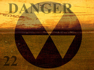 grunge industrial background design with danger warning and radiation symbol
