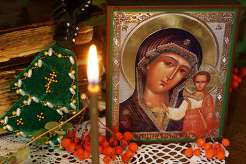 Religious orthodox still life with an icon of the Holy Mother and burning candle