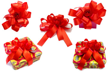 Gift box tied with a red bow on white background.
