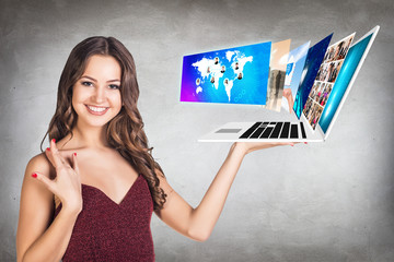 Young woman holds laptop