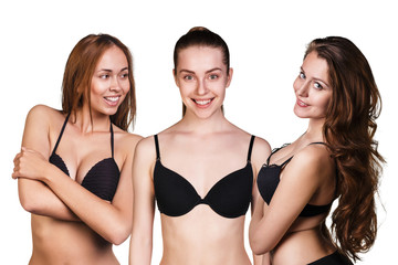 Three beautiful sexy women showing their black bra