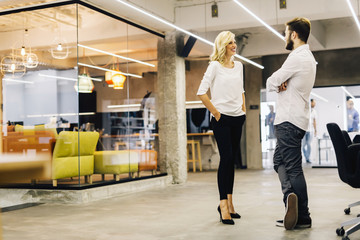 Two intelligent coworkers talking