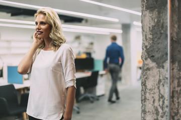 Confident businesswoman walking in office