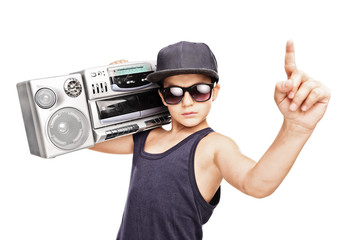 Junior rapper carrying a ghetto blaster and gesturing