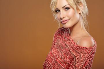 Beautiful blonde woman portrait in autumn color. Studio shoot