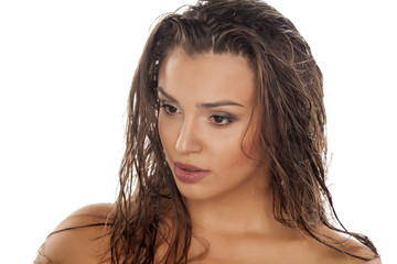 beautiful young woman with wet hair posing in the studio