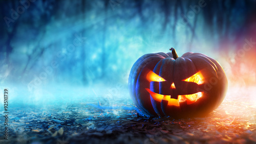 Halloween Pumpkin In A Mystic Forest At Night