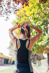 Women tied hair before running
