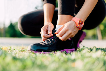 Close up of a runner preparing his shoes for a run