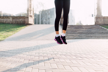 Runner jumping on hard