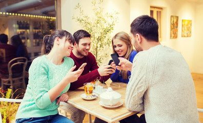 group of friends with smartphones meeting at cafe