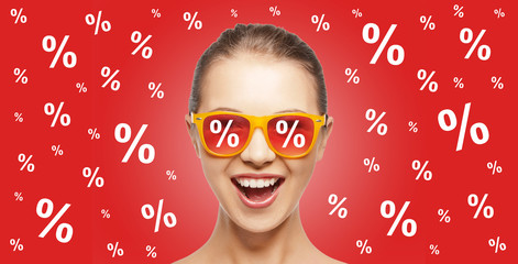 happy teenage girl in shades with percentage signs