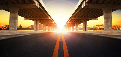 sun rising behind perspective on bridge ram construction and asp