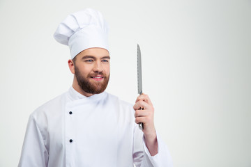 Portrait of a happy chef cook holding knife