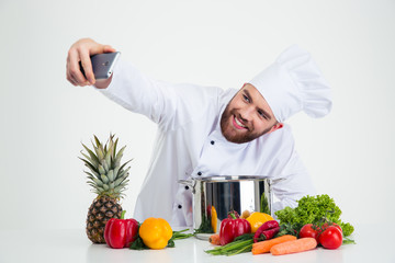 Male chef cook making selfie photo