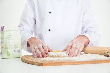 Male hands preparing dough for pastry
