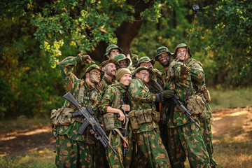 Selfie! soldiers taking pictures in the forest