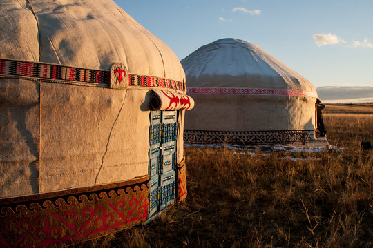 Kazakh yourt in evening steppe.