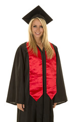 woman in black graduation gown stand smile