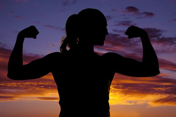silhouette of woman fitness flex both arms close