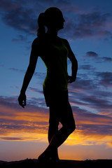 silhouette of a woman fitness posing