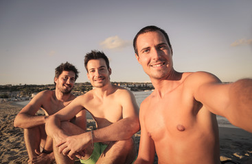 Three friends doing a selfie at the beach
