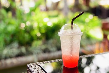 Strawberry's Italian soda on a natural background.