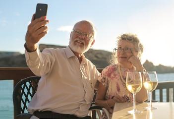 Elderly couple doing a selfie