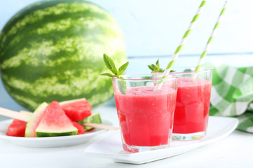 Fresh watermelon juice in the glass on wooden table